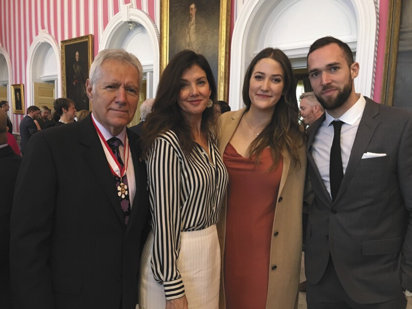 Alex Trebek receives the Order of Canada with his wife, Jean, daughter Emily and son Matthew.