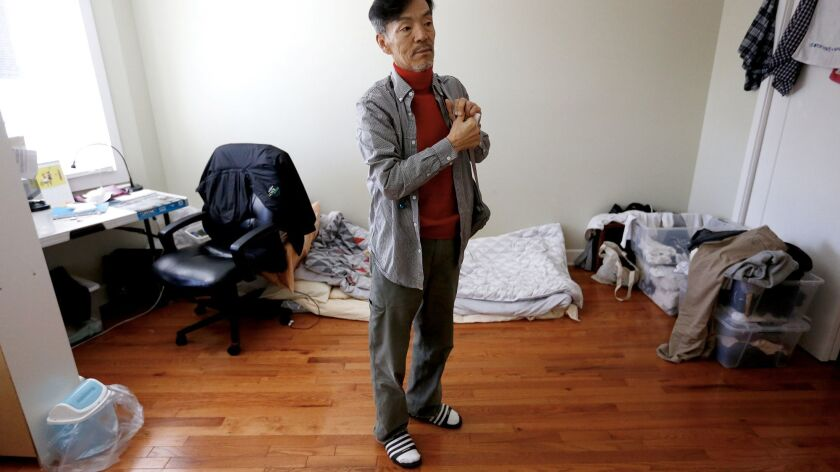 Seon Jin Kim shares a room with another tenant in Adullam, an unofficial homeless shelter for Korean