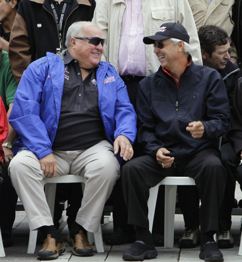 """FILE - In this May 28, 2011, file photo, Four-time Indy 500 winners A.J. Foyt, left, and Rick Mears share a laugh during a photo session before the drivers' meeting for the Indianapolis 500 auto race at the Indianapolis Motor Speedway in Indianapolis. In the lead-up to the 100th running of the """"The"""