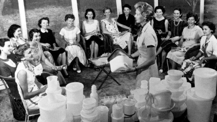 Women gather at a Tupperware home party in 1958. Multilevel marketing companies have often focused on women as salespeople and clients.