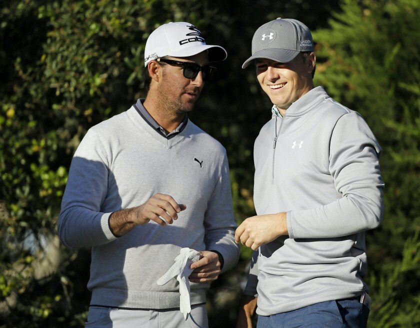 FILE- In this Feb. 2, 2015, file photo, country music star Jake Owen, left, talks with his playing partner Jordan Spieth, right, on the third tee of the Monterey Peninsula Country Club Shore Course during the first round of the AT&T Pebble Beach National Pro-Am golf tournament in Pebble Beach, Cali