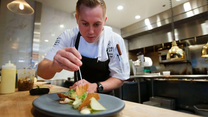 Executive chef Scott Cannon prepares hamachi crudo at The Cork & Craft in Rancho Bernardo.