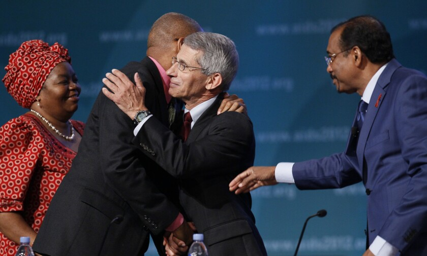 Sheila Tlou, Phill Wilson, Anthony Fauci, and UNAIDS Executive Director Michel Sidibe, gather on stage