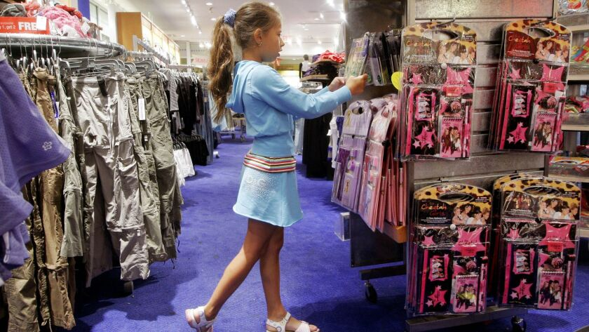 Karina Shumko, 10, shops for back-to-school items at a Limited Too store Monday, Aug. 28, 2006 in th