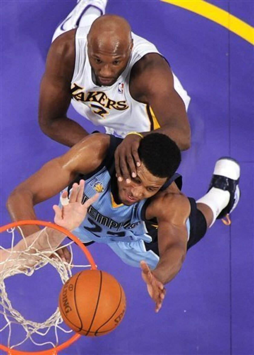 Los Angeles Lakers forward Lamar Odom, top, hits Memphis Grizzlies forward Rudy Gay in the face as they go after a rebound during the first half of their NBA basketball game, Sunday, Jan. 2, 2011, in Los Angeles. (AP Photo/Mark J. Terrill)