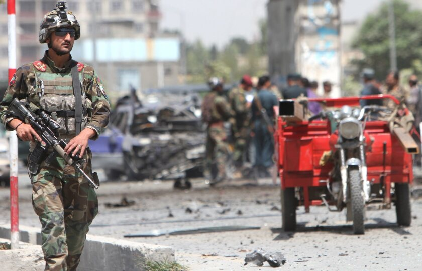 Afghan soldiers inspect the site of a suicide bombing in Kabul on Aug. 10.