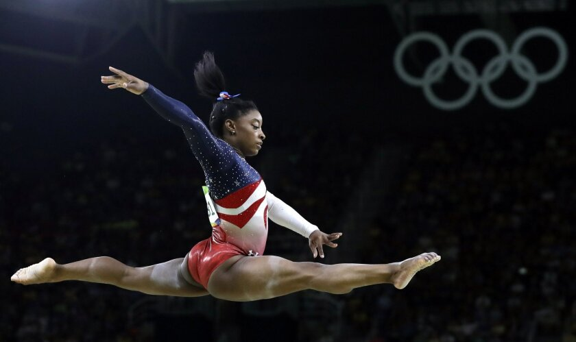 United States' Simone Biles performs on the balance beam during the artistic gymnastics women's team final at the 2016 Summer Olympics in Rio de Janeiro, Brazil, Tuesday, Aug. 9, 2016. (AP Photo/Rebecca Blackwell)