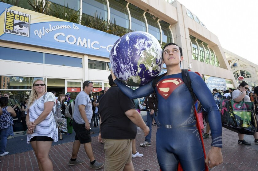 Bersain Gutierrez, dressed as Superman, poses in front of the convention center before Preview Night at Comic-Con International held at the San Diego Convention Center Wednesday July 20, 2016, in San Diego.