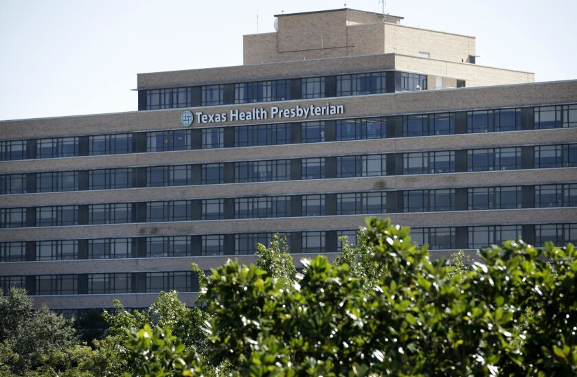The main building of the Texas Health Presbyterian Hospital Dallas complex is shown, Thursday, Oct. 16, 2014, in Dallas.  Dallas County commissioners will consider issuing a disaster declaration after Ebola has left a man from Liberia dead and two nurses infected. Commissioners scheduled an emergen