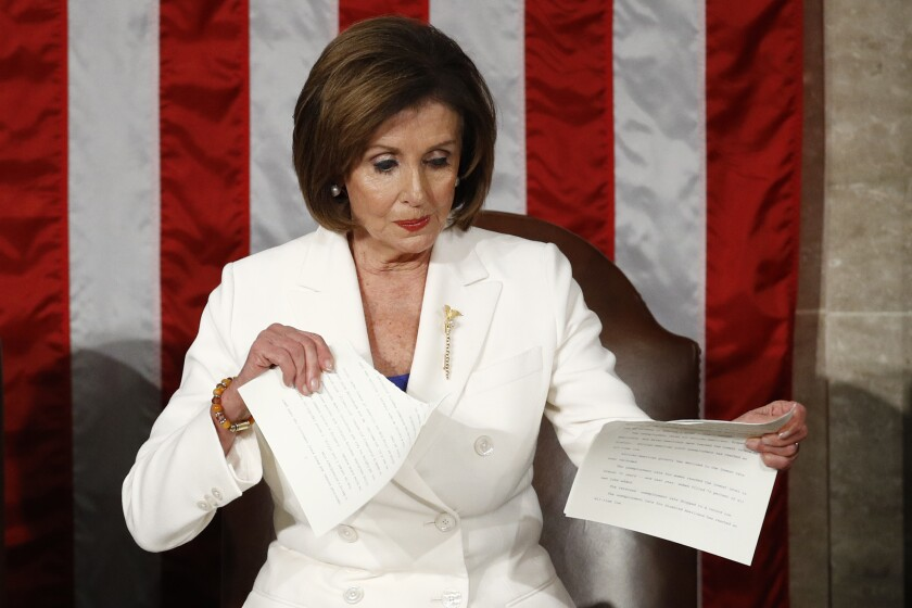 FILE - In this Tuesday, Feb. 4, 2020, file photo, House Speaker Nancy Pelosi, of California, tears her copy of President Donald Trump's State of the Union address after he delivered it to a joint session of Congress on Capitol Hill in Washington. (AP Photo/Patrick Semansky, File)