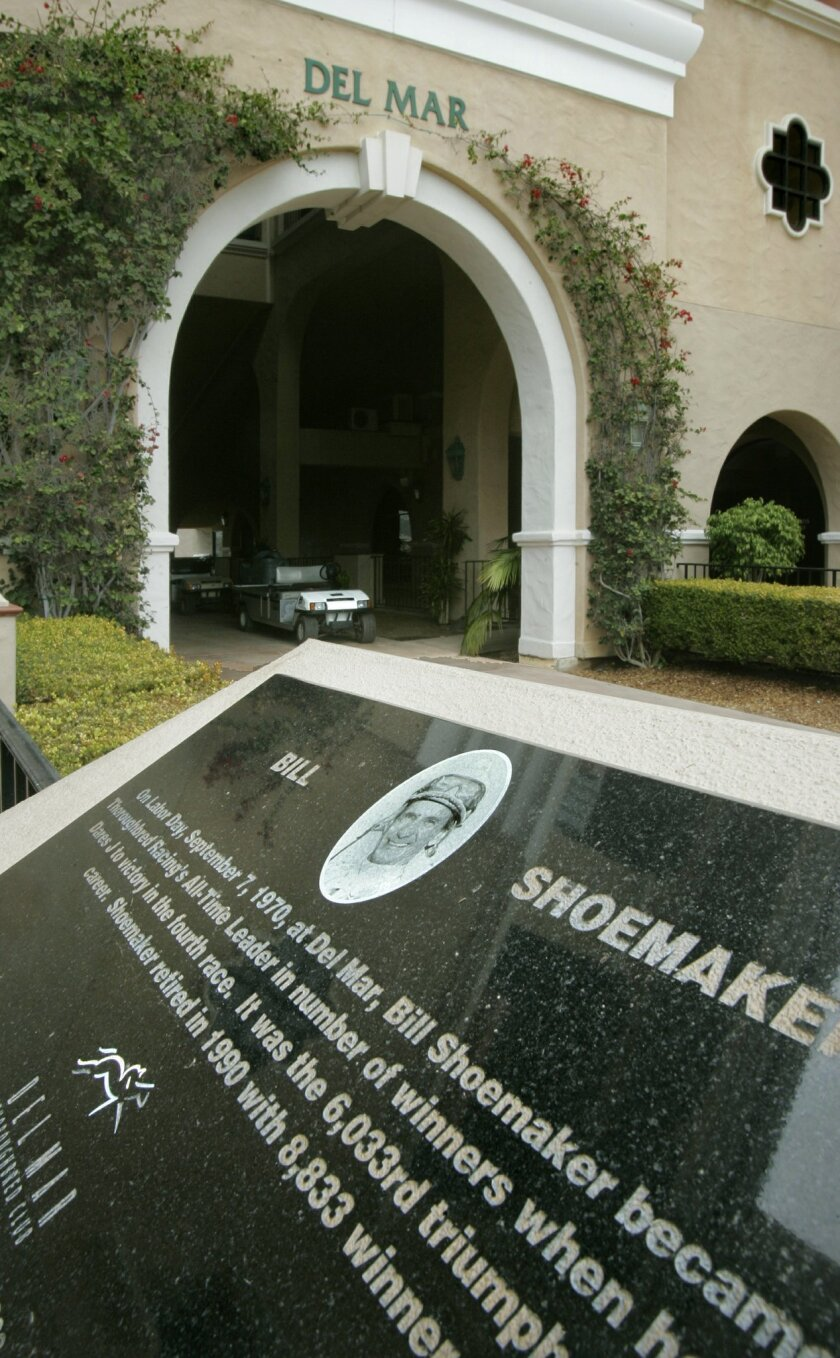 A plaque commemorates Bill Shoemaker near the tunnel that the horses and jockeys take to get to the Del Mar Racetrack.