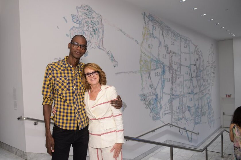 """Mark Bradford joins Hammer Museum director Ann Philbin at a party that celebrated two exhibitions, including his """"Scorched Earth."""""""