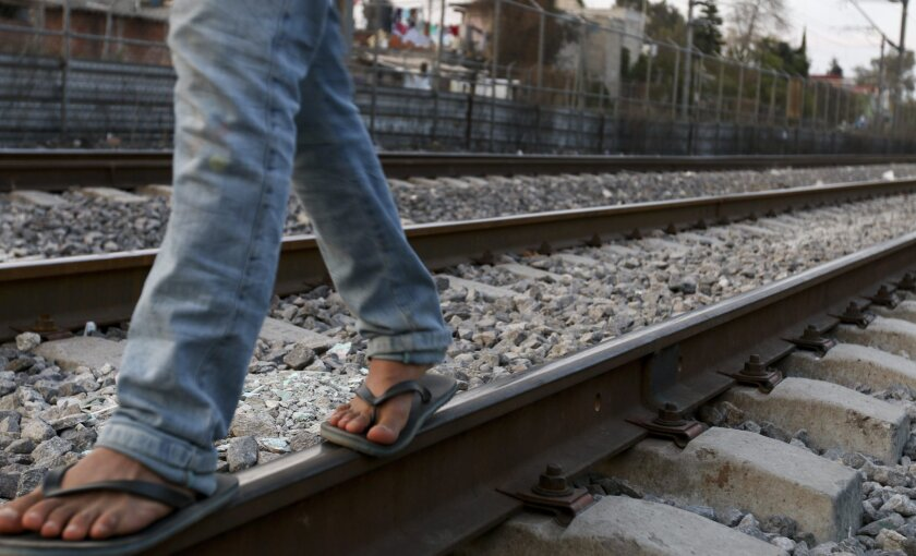 Migrants from Central American have found it increasingly difficult to cross Mexico to reach the United States. Berfilio Hernandez, 21, from Peten, Guatemala, walks along train tracks in Tultitlan, Mexico, last year.