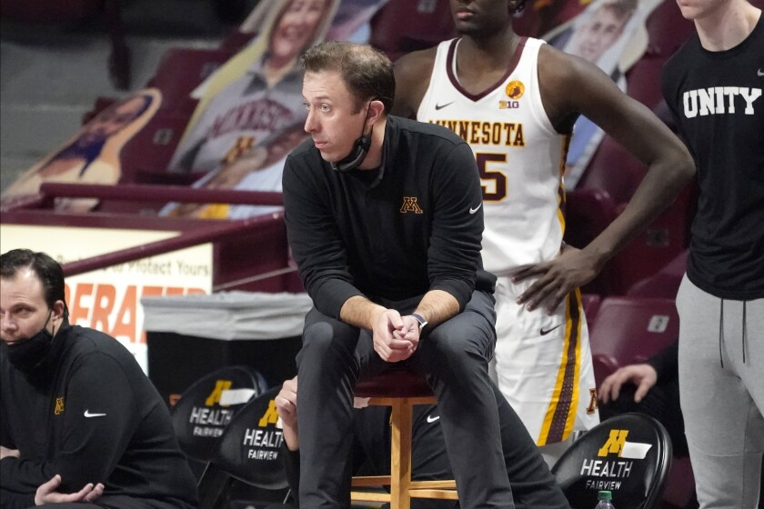 Minnesota head coach Richard Pitino watches his team during overtime of an NCAA college basketball game against Rutgers, Saturday, March 6, 2021, in Minneapolis. Rutgers won 77-70. (AP Photo/Jim Mone)