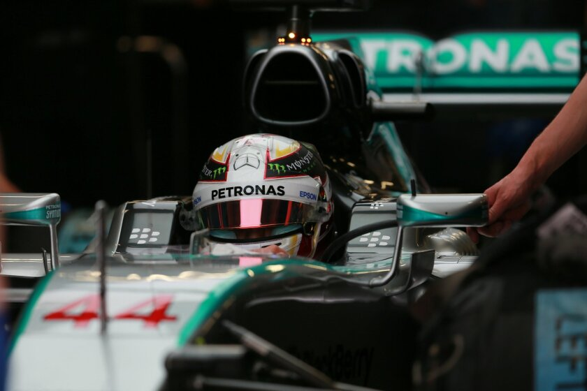 Mercedes driver Lewis Hamilton of Britain sits inside his car while waiting to leave the pits during the third practice session for the Formula One Mexico Grand Prix auto race at the Hermanos Rodriguez racetrack in Mexico City, Saturday, Oct. 31, 2015. (AP Photo/Christian Palma)