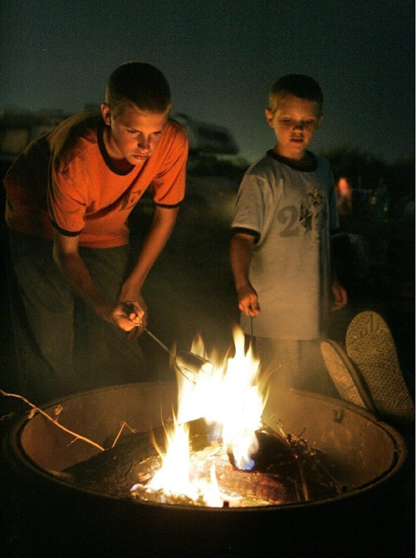 Brothers Hunter (left) and Dylan Jackman roasted marshmallows for s'mores last week at their  campsite at San Onofre State Beach.
