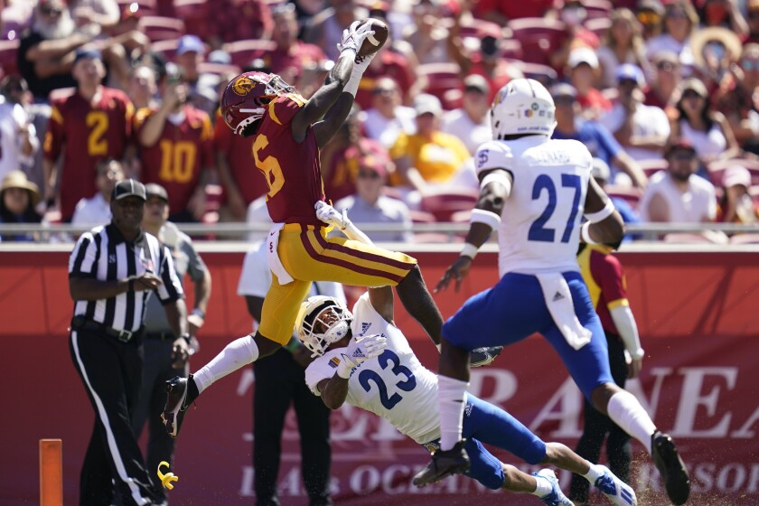 Southern California wide receiver Tahj Washington (16) catches a pass in the end zone for a touchdown during the first half of an NCAA college football game against San Jose State Saturday, Sept. 4, 2021, in Los Angeles. (AP Photo/Ashley Landis)