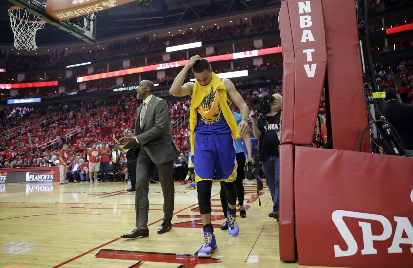 Golden State defeats Houston, 121-94, but Stephen Curry is hurt and will have MRI