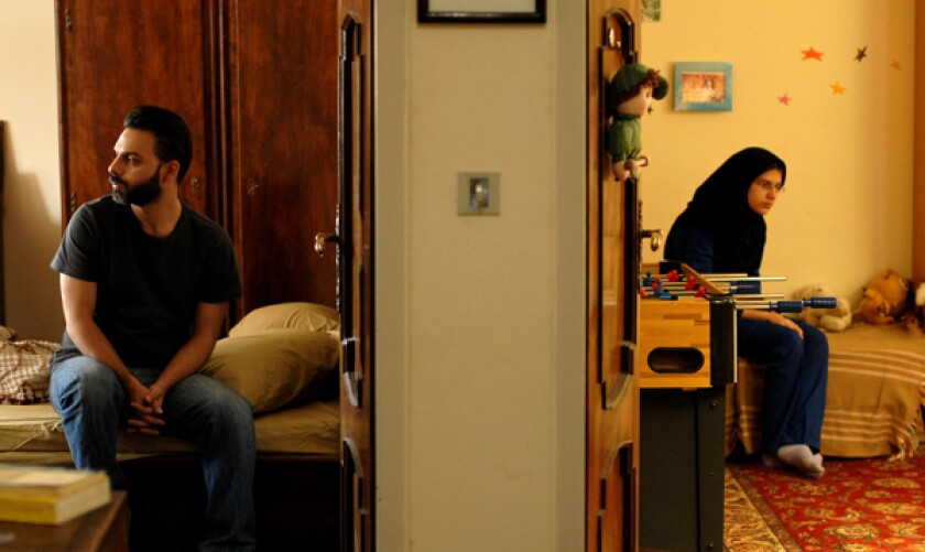 "Peyman Moadi as Nader, left, and Sarina Farhadi as Termeh in a scene from ""A Separation."""