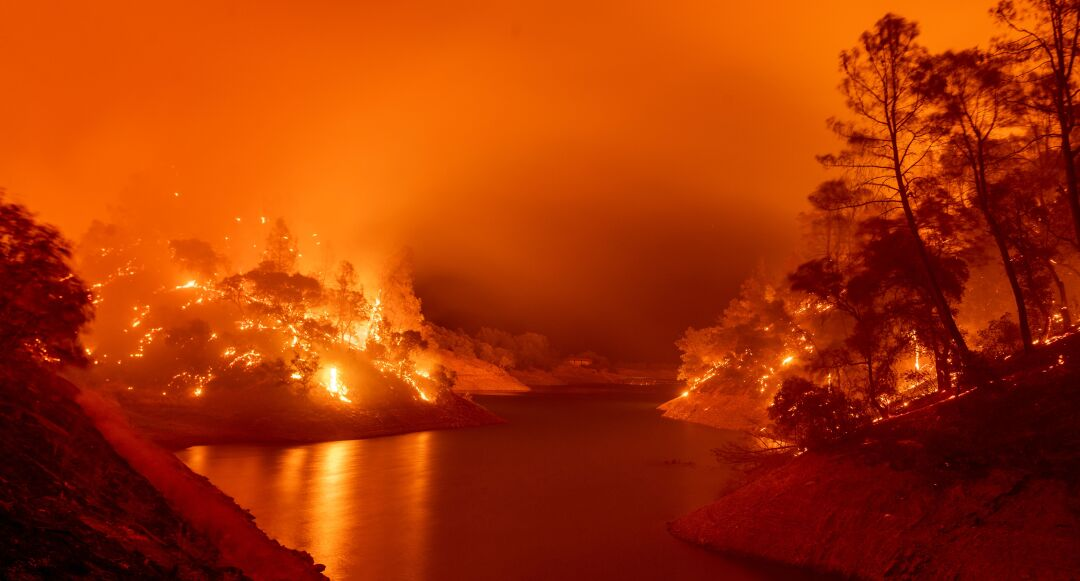 Flames consume both sides of a segment of Lake Berryessa in Napa County.