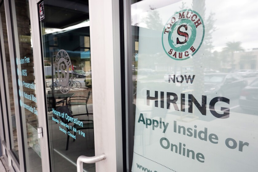 In this Nov. 4, 2019 file photo a job posting is displayed near the entrance outside a restaurant in Orlando, Fla.