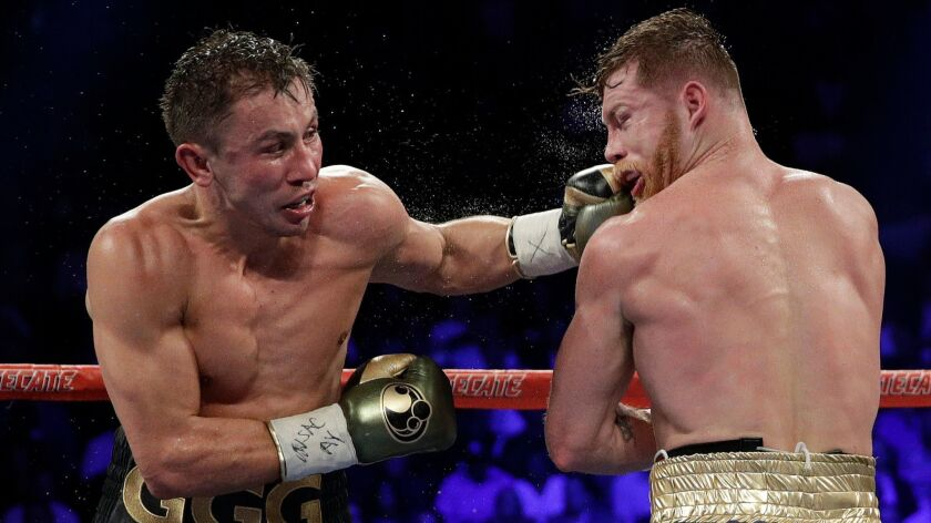 FILE - In this Sept. 17, 2017 file photo shows Gennady Golovkin, left, connects with a left to Canel