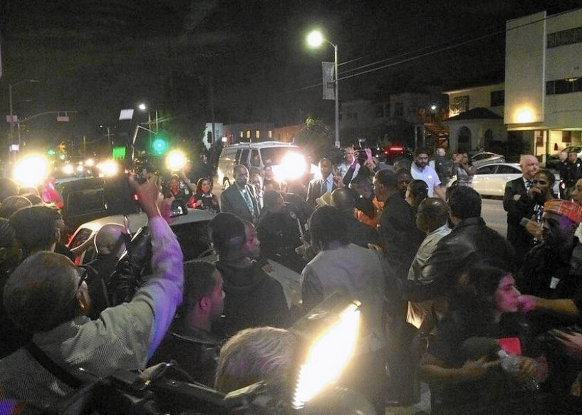 Black Lives Matter protesters swarm Mayor Eric Garcetti's car after a town hall meeting in South L.A.