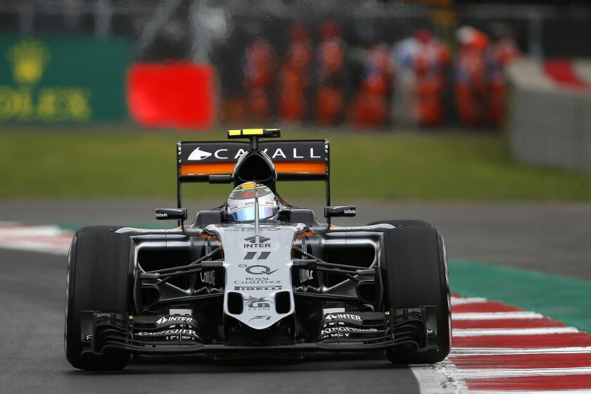 Force India driver Sergio Perez of Mexico drives his car during the third practice session for the Formula One Mexico Grand Prix auto race at the Hermanos Rodriguez racetrack in Mexico City, Saturday, Oct. 31, 2015. (AP Photo/Eduardo Verdugo)
