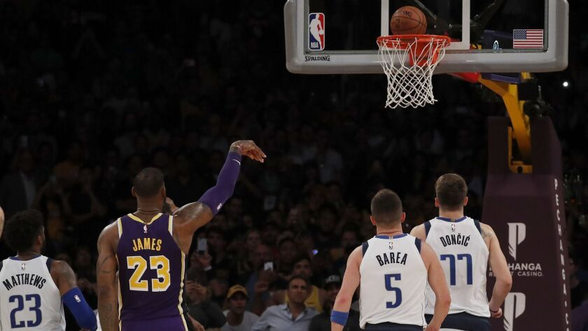 Lakers' LeBron James sinks the second of two free throws to put the Lakers up, 114-113, against the Mavericks with about three seconds left to play in the game on Oct. 31, 2018, at Staples Center.