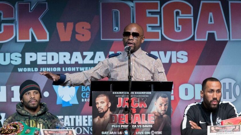 Retired boxer Floyd Mayweather Jr. speaks at a news conference in New York on Jan. 12 for a bout between James DeGale and Badou Jack.