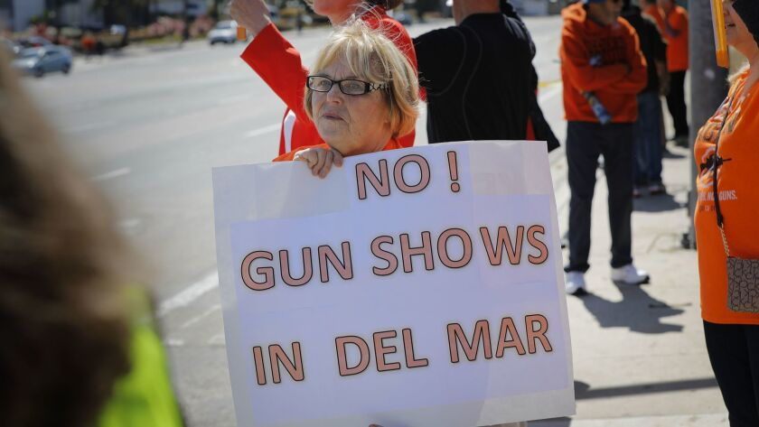 Sherryl Parks was one of about 80 people from NeverAgainCa who protested outside the Del Mar Fairgrounds against the Crossroads of the West Gun Show Saturday.