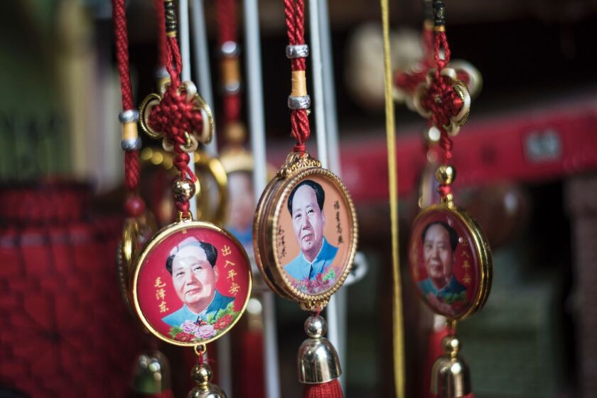 Pendants with portraits of late Chinese chairman Mao Tse-tung for sale in a shop in Beijing on May 16, 2016.