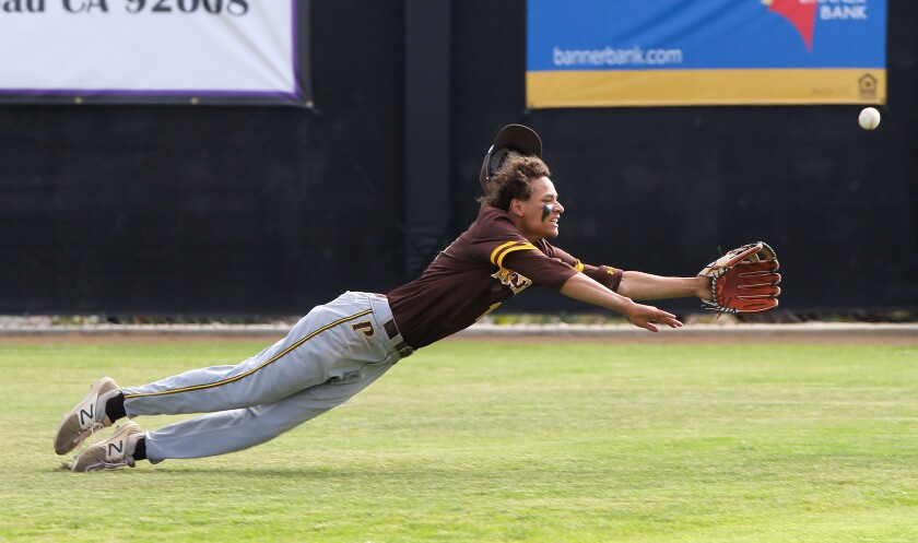 Francis Parker right fielder Matthew Baker-Dunn misses a deep fly ball hit by Carlsbad's Konrad Bohnert that went for an RBI triple.