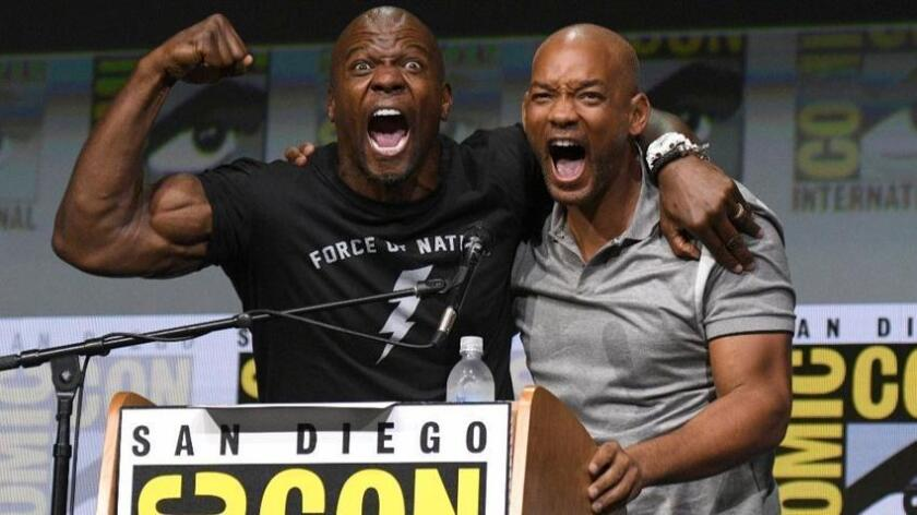 """Terry Crews, left, and Will Smith pose at the Netflix Films' """"Bright"""" panel on day one of Comic-Con International on Thursday, July 20, 2017, in San Diego. (Photo by Al Powers/Invision/AP)"""