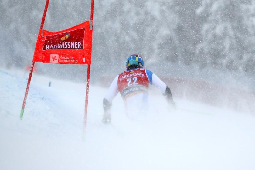 Switzerland's Justin Murisier competes during the second run of an alpine ski, World Cup men's giant slalom in Santa Caterina Valfurva, Italy, Saturday, Dec. 5, 2020. (AP Photo/Gabriele Facciotti)