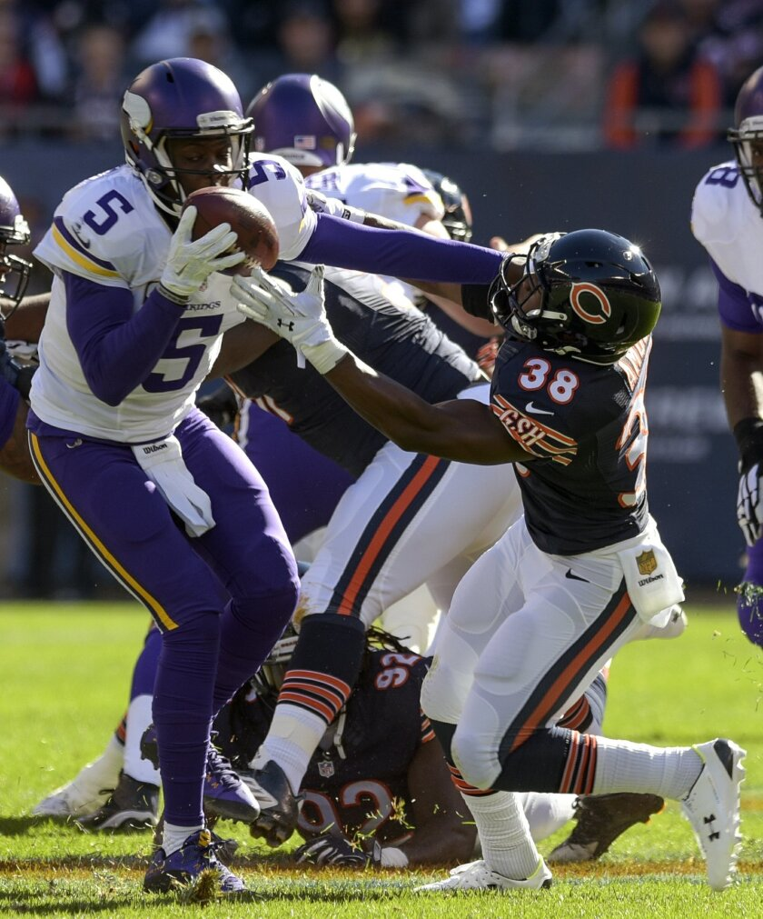 Minnesota Vikings quarterback Teddy Bridgewater (5) keeps the ball from Chicago Bears free safety Adrian Amos (38) during the first half of an NFL football game in Chicago, Sunday, Nov. 1, 2015. (Mark Black/Daily Herald via AP) MANDATORY CREDIT; MAGAZINES OUT