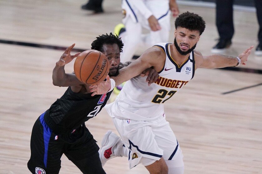 Clippers guard Patrick Beverley, left, is pressured by Denver's Jamal Murray.