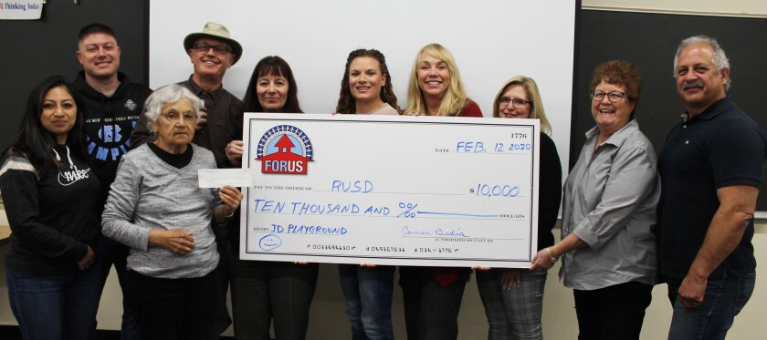 Friends of Ramona Unified Schools (FORUS) donates $10,000 to Ramona Unified School District towards a new playground at James Dukes Elementary School. From left are FORUS members Perla Martinez, Kevin Barger, Carmen Bedia and Greg Chick; RUSD Superintendent Theresa Grace; JDE PTA President Andrea Warner and Principal Jeri Billick; RUSD Assistant Superintendent of Administrative Services Rena Seifts; and FORUS members Amy Barraclough and Bob Stoody.