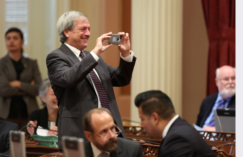 Then-state Sen. Mark DeSaulnier, D-Concord, takes a photo during the 2014 Senate session. DeSaulnier was diagnosed with leukemia shortly after being elected to Congress.