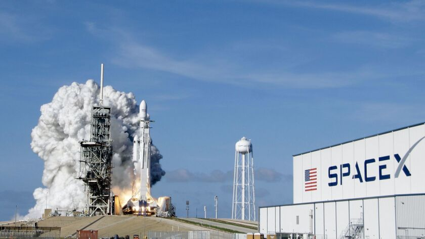 A SpaceX Falcon Heavy rocket lifts off from pad 39A at the Kennedy Space Center in Cape Canaveral, Fla., on Feb. 6. The company is building an even bigger rocket for flights to Mars.