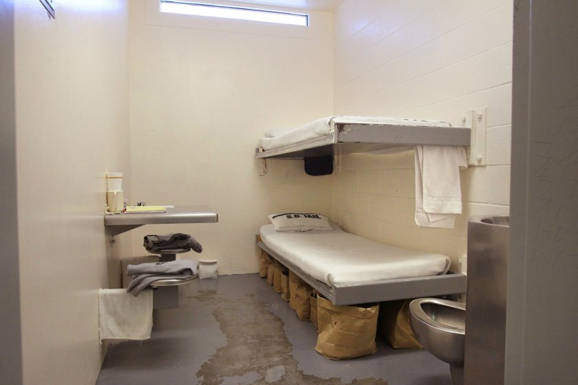 An inmate cell at the Vista Detention Facility has double bunks, toilet, and table bolted into wall