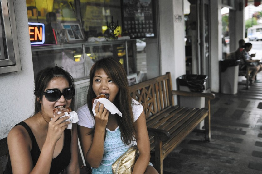 Go ahead and swoon over Hawaii's sugary, addicting malasadas