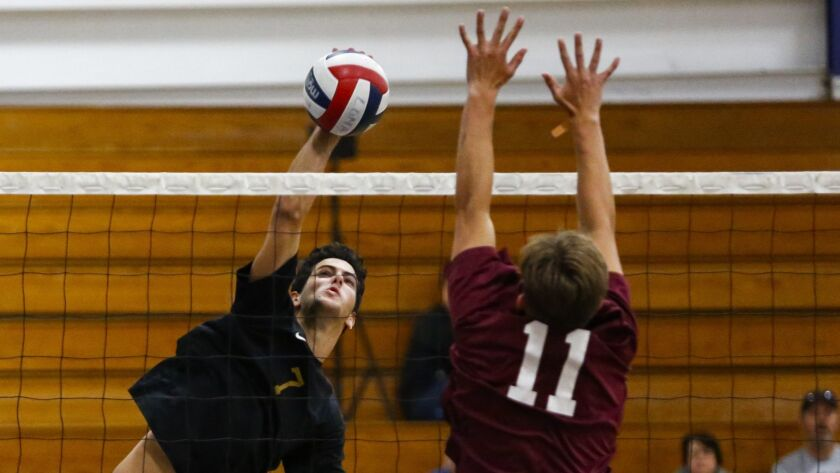 Point Loma's Marco Pasada spikes a shot over Paloma Valley's Nolan Walsh during the first set.