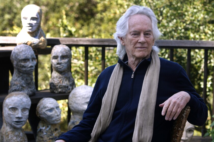 Beat poet Michael McClure is seen on his deck with sculptures by his wife, artist Amy Evans McClure, at their home in Oakland, Calif., in 2010. His career as a poet eclipsed most of his Beat generation contemporaries.