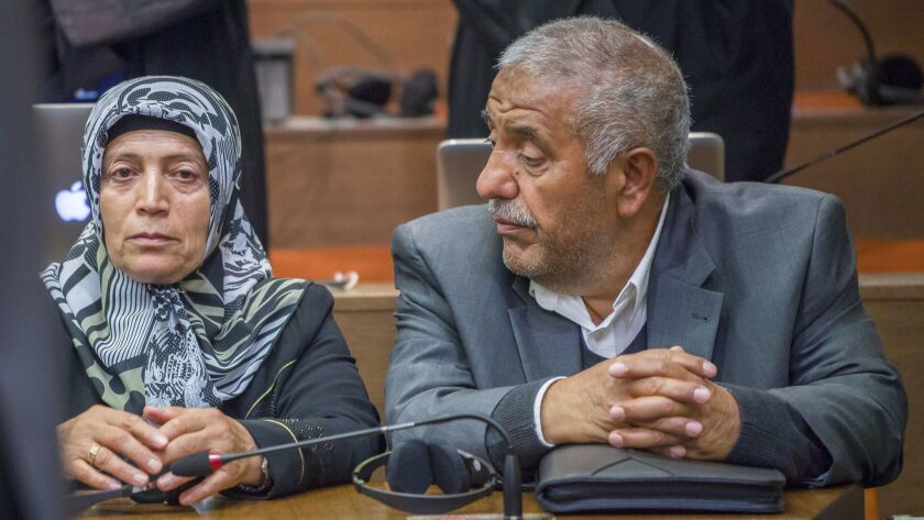 Ayse Yozgat, left, and Ismail Yozgat, parent of killed Halit Yozgat, sit in the court in Munich, sou