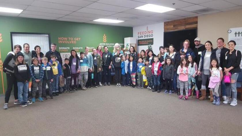 Torrey Pines Elementary School families celebrate their efforts of sorting food for Feeding San Diego.