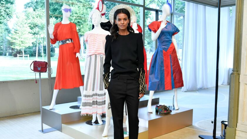Liya Kebede poses with outfits donated by designers.