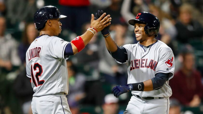 Cleveland Indians outfielder Greg Allen (right) is congratulated by shortstop Francisco Lindor after hitting two-run home run off Chicago White Sox relief pitcher Jace Fry during the seventh inning at Guaranteed Rate Field.