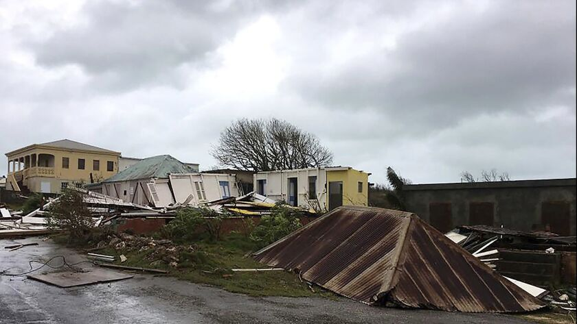 This Sept. 6, 2017, photo shows storm damage in the aftermath of Hurricane Irma on the British island of Anguilla. Some businesses and government agencies on the Caribbean island used the Titan HST app to determine whether employees were safe during and after the storm.