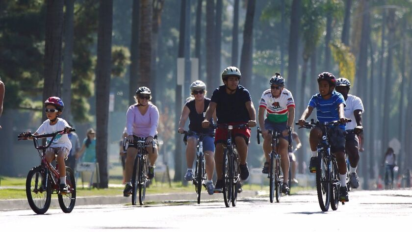 Bicyclists ride on Sixth Avenue during the third annual CicloSDias.
